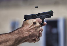 Handgun being shot Royalty Free Stock Photo