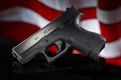 Handgun. On black with flag Stock Photo