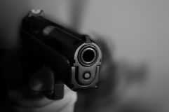Handgun. Black and white photo of a handgun with motion blur royalty free stock photo