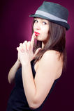 Handgun blow gesture & beautiful young woman Stock Photos