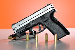 Handgun and Bullets Stock Photography