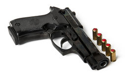 Handgun and bullets. Isolated on white background Stock Photos