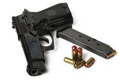 Handgun and bullets Stock Photo