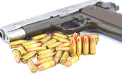 Handgun and bullets Stock Images