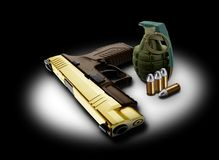 Handgun bullets and granade Royalty Free Stock Photos
