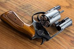 Handgun with bullets Stock Images