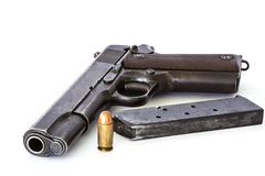 Handgun and bullets magazine Stock Photos