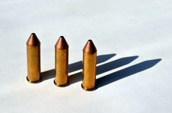 Handgun bullets. On white background in strong sunlight Royalty Free Stock Photography