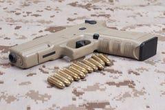 Handgun on camouflage uniform Stock Photos