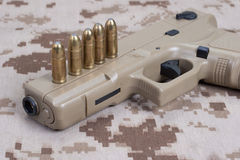 Handgun on camouflage uniform Royalty Free Stock Image