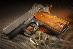 Handgun and cartridges Stock Photos