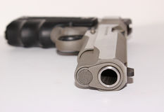 Handgun. A closeup of the barrel of a handgun royalty free stock photos