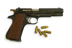 Handgun Colt with bullets Royalty Free Stock Photo