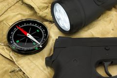 Handgun, Compass And Led Tourchlight On The Backpack Stock Photography