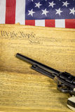 Handgun with the Constitution and American Flag Royalty Free Stock Photos