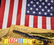 Handgun with the constitution and flag Royalty Free Stock Photography