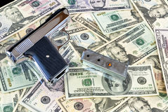 Semi Automatic Pistol on a pile of cash Stock Photography