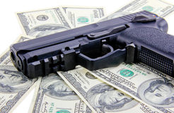 Handgun on dollar notes Royalty Free Stock Image