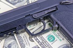 Handgun on dollar notes Stock Photography