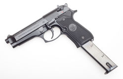 Handgun with extended magazine Stock Images