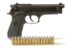 Handgun  and fifteen bullets Royalty Free Stock Images