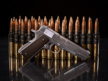 Handgun in front of bullets Royalty Free Stock Photos
