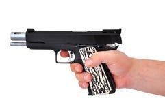Handgun in hand Royalty Free Stock Photo