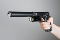 Handgun in the hand Royalty Free Stock Image
