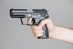 Handgun in the hand Stock Photos