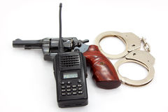 Handgun and Handcuff with Police Radio communication Royalty Free Stock Photos