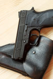 Handgun and holster stock images
