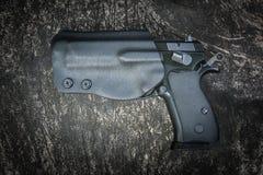 Handgun in holster Royalty Free Stock Image