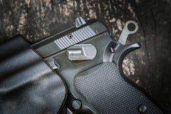 Handgun in holster Stock Photo