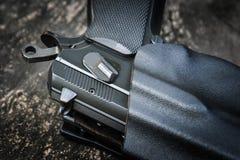 Handgun in holster Stock Images