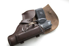 Handgun in a holster on a white background Stock Photos