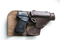 Handgun in a holster on a white background Royalty Free Stock Photos