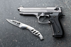 Handgun and knife Stock Photography