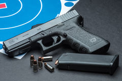 Handgun. Las Vegas, NV, USA - January 25, 2016:  Closeup of  Glock 17 semiautomatic handgun and 9mm amunition and magazine Royalty Free Stock Photos