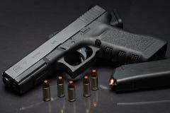 Handgun. Las Vegas, NV, USA - January 25, 2016:  Closeup of  Glock 17 semiautomatic handgun and 9mm amunition and magazine Royalty Free Stock Image