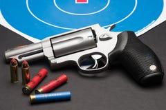Handgun. Las Vegas, NV, USA - January 25, 2016:  Closeup of  Taurus Judge 4510 revolver with .410 guage  and .45 long Colt ammunition Royalty Free Stock Image