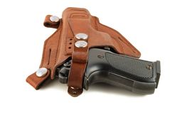 Handgun in a leather holster Stock Photos