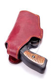 Handgun in a leather holster Stock Images