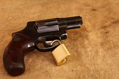 A handgun with a log around the trigger Royalty Free Stock Photography