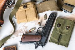 Handgun M1911 government with ammo royalty free stock photography