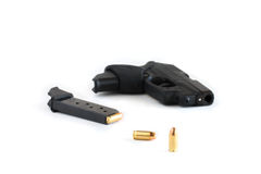 Handgun and magazine loaded with cartridges. Royalty Free Stock Image