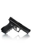 Handgun with natural reflection. Handgun closeup on white with natural reflection on glass Royalty Free Stock Images