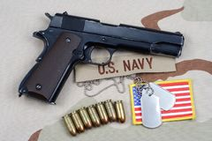 Handgun on navy uniform. Background Royalty Free Stock Photography