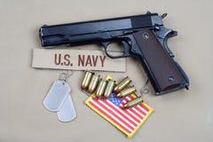 Handgun on navy uniform. Background Royalty Free Stock Photo