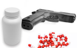 Handgun with pills,life goes downhill Royalty Free Stock Image