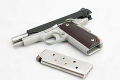 Handgun pistol firearms bullet Royalty Free Stock Photos